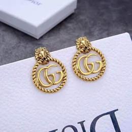Messing löwen online-New Löwenkopf Ohrringe heiße Art Messing Retro-Design Ringe mit glänzenden beschrifteten Ohrringe
