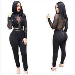 Mono de manga larga discoteca online-Sexy Negro Lace up Diseño Mujeres Skinny Nightclub Jumpsuits Ver a través de mangas largas Zipper Back Hottest Party Jumpsuits
