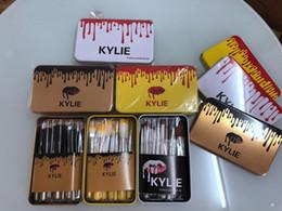 polvos cosméticos kylie Rebajas Kylie alta calidad herramientas de maquillaje maquillaje profesional cepillo del sistema de viaje caja de hierro portátil set 12 PC fijó el cepillo de polvo cosmético
