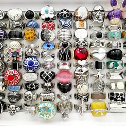 Lo nuevo 50 unids / lote plata oro 316L anillos de acero inoxidable moda Vintage Punk anillo del cráneo para mujer para hombre joyería de titanio regalos del banquete de boda desde fabricantes