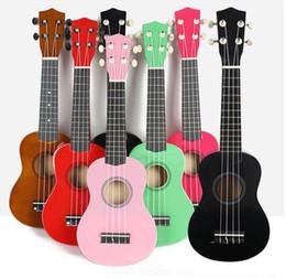 Guitarra havaiana on-line-Frete grátis 21 polegada ukulele pequeno brinquedo de quatro cordas guitarra Hawaiian violão de madeira ukulele