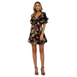 0b8151d4 Moda mujer boho estampado floral beach dress 2018 nueva dama del verano  fiesta de noche de manga corta con cuello en v mini vestido