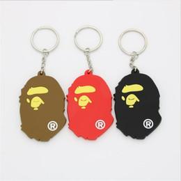 Catene di scimmie online-Catene chiave unisex del PVC della testa della scimmia Modello sveglio Uomini donne Catene chiave dell'automobile Marca Amanti di disegno adorabili Catene chiave di fascino