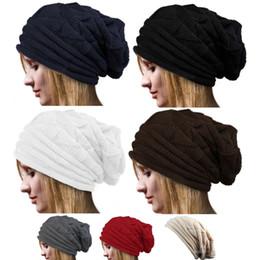 DHL FREE Nuevos sombreros de invierno con agujero de punto gorros de punto  gorros para mujeres niñas Sombreros de lana de cola de caballo 7 colores  para ... 417de339da2