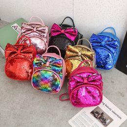 Niños mochilas niños online-niños mochila niños coreanos 2019 lindo arco de lentejuelas de cuero mochilas niños niñas mochilas escolares diseñador de moda bolsa de aseo bolsa de cosméticos
