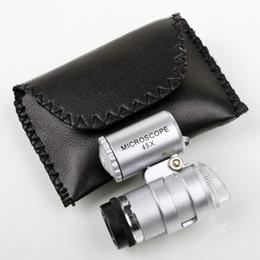microscopi della lampada Sconti Microscopio 45X Gioielliere Lente d'ingrandimento Lenti per gioielli Mini Lenti d'ingrandimento Microscopi tascabili con luce LED + Lente d'ingrandimento custodia in pelle MG10081