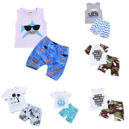 2020 marca de vestuário dolphin Crianças roupas de grife roupas meninos crianças tubarão golfinho impressão top + calções de Camuflagem 2 pçs / set 2019 Verão Boutique Conjuntos de Roupas de bebê C6527 marca de vestuário dolphin barato