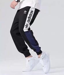 Pantalones de cordón para hombre online-Nuevos pantalones de moda de marca para hombre Pantalones deportivos corredores con al por mayor AD Cartas de primavera Hombres pantalón con cordón elástico Joggers Ropa