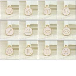 Encantos do zodíaco esmalte on-line-Atacado 72 pçs / lote esmalte liga de ouro-cor jóias mistos zodíaco pingentes encantos para pulseira colar de jóias DIY fazendo