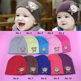 Pipistrelli neonati online-Newborn Baby Infant Girls Boys Polka Dot Bear Bowknot Caps Hats Spring Autumn Crochet Cute Cotton Beanie 10 Colors