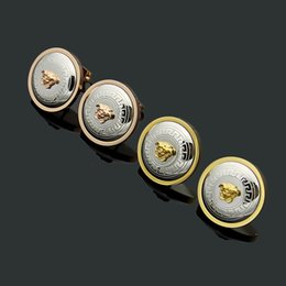 Marque de luxe bijoux de créateurs femmes boucles d'oreilles en acier au titane 316L petites boucles d'oreilles rondes en or 18 carats couple d'hommes et de femmes aiment boucles d'oreilles cadeau ? partir de fabricateur