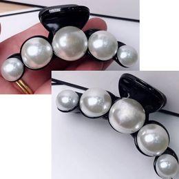 Clip de chicas online-7x2.5 CM moda coreana de estilo C de la perla clip de la garra una palabra clip chica horquilla europea y americana damas colección contador vip regalo 2 / lote