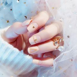 Обнаженные женщины для искусства онлайн-Women Fashion Nude Pink Color False Nails Girls Cute 3D Rivet Fake Nails Middle-long Size Full Cover Nail Art Tips with Glue