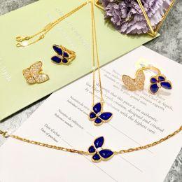 Orecchino di design a forma di parigi in ottone con diamante e forma di farfalla in pietra di Lapislazzuli per gioielli da donna cheap earrings stone woman da orecchini donna in pietra fornitori