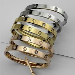 polsini in titanio all'ingrosso per gli uomini Sconti vendita calda amore 316L titanio braccialetto croce braccialetto per le donne gli uomini cacciavite amore Bracciale braccialetto all'ingrosso