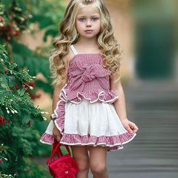 2019 rotes tartanhemd Mädchen Kleidung Neue Sommer Big Bowknot Schwarz Rot Tartan Plaid Ärmelloses T-shirt Baby Mädchen Tops Plissee Hosenrock 2 STÜCKE Set Kinder Kleidung Q10 rabatt rotes tartanhemd