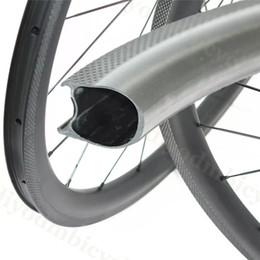 Fábrica de vendas 700C carbono Wheelset 38 milímetros 25 mm de largura sem câmara de carbono Rodas de bicicleta Clincher Road Bike Wheels 255 ° frenagem Superfície de