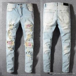 Vend des jeans déchirés en Ligne-Nouvelle marque jeans célèbre designer mode pantalons AMIRI jeans mens trou pantalon pantalon patch décontracté pieds pantalons vente chaude pantalon mince nouvelle 1: 1