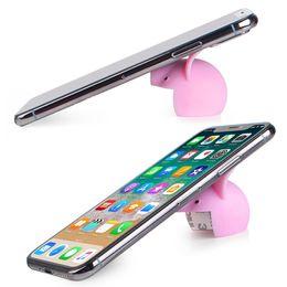 Universal 2 colores mini cerdo Gel de sílice Tabletas para teléfonos celulares Soporte de soporte de escritorio para PC Soporte y mini cerdos para evitar lesiones desde fabricantes