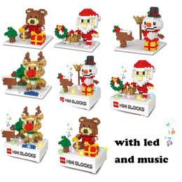 Caixas de bloco on-line-Natal blocos de construção com a música levou veados 3D Assembléia Papai Noel boneco de suportar ABS pacote da caixa Figuras de Ação miniatura de plástico