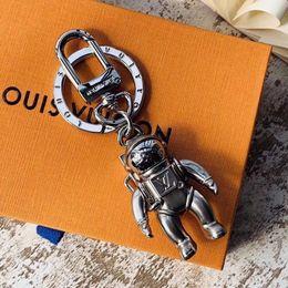 llaveros coche jaguar Rebajas Cadena dominante del coche de moda de metal sólido de alta calidad llavero creativo de la marca astronauta diseño hombres y mujeres de lujo cadena dominante caja de regalo embalaje