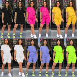 mulheres vestindo uniforme de enfermeiras Desconto Mulheres Verão Designer de Cor Sólida 2 Pcs Calças de Manga Curta Estilo de Moda Esportiva Feminino Vestuário Casual Vestuário