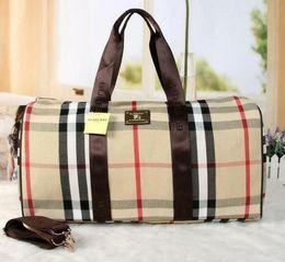 Maletas de mujer vintage online-Hot brand hombres mujeres bolsa de viaje bolsa de lona de lona Vintage diseñador de la marca bolsos de equipaje gran capacidad bolsa de deportes