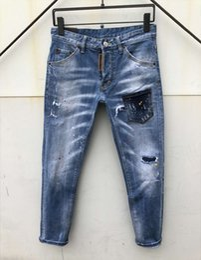 Venta al por mayor- Skull UMMEWALO Jeans estampados para hombres Casual Jeans rectos de diseñador Pantalones rojos para hombre Marca de impresión Pantalones Jeans Hombre desde fabricantes