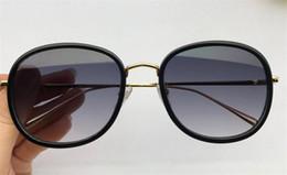 2019 alla moda nuovo top della moda di moda Nuovi occhiali da sole alla moda di design 1067 occhiali da sole di alta qualità con montatura tonda di alta qualità con scatola alla moda nuovo top della moda di moda economici