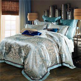 Ropa de cama jacquard de oro rosa online-TUTUBIRD-Ropa de cama de seda de jacquard de lujo azul rojo rosa plata oro satinado juego de cama reina rey tamaño edredón hoja de cubierta 4 unids