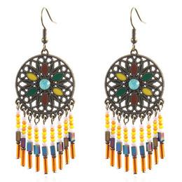 da04966ff European And American Fashion Jewelry Retro Bohemian National Wind Earrings  Long Rice Beads Tassel Earrings
