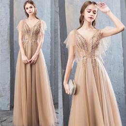 champanhe de organza Desconto 2019 vestidos de champagne graça sexy sem mangas com decote em v sem encosto até o chão vestidos de baile vestidos de noite vestido de baile