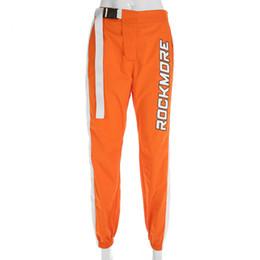 Pantaloni a vita bassa con patchwork casual Pantaloni a vita con fibbia a vita alta Pantaloni da donna con zip color oro Pantaloni sportivi e jogging Fitness cheap orange color pants da pantaloni di colore arancione fornitori
