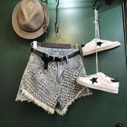 jeans étnicos Rebajas 2019 Nuevas mujeres de la moda estilo europeo remaches de cintura alta remiendo borla franja flecos pantalones de mezclilla pantalones cortos S M L XL