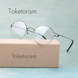 74ef0ad20ccc7 2019 óculos coreanos Toketorism artesanal Coreano sem parafusos eyewear  titanium liga leve rodada óculos óculos de