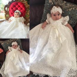 2019 vestido de comunión escote ilusión Princesa del bebé blanco de encaje vestidos de primera comunión perlas Vestido con cuentas de manga corta de las muchachas con la cinta Fajas niños Partido Prom Vestidos Largos