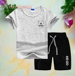 Ropa niños online-Nueva marca de diseño para niños, niñas, niños, ropa deportiva, niños, mangas cortas, traje para niños, ropa de verano 2-7 T