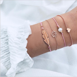 Elegantes brazaletes de perlas online-Señoras 4 Unids / set Encanto Brazalete de Cuerda Trenzada Flor Pulsera de Perlas Elegante Mujer Multicapa Flores de Loto Hoja Corazón Tobillera Brazaletes