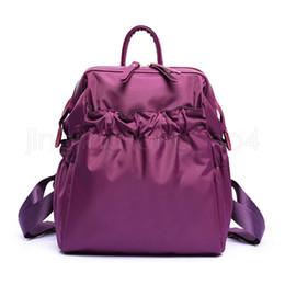 высокие рюкзаки Скидка Нейлон водонепроницаемый рюкзак Мода Мужчины женщины сплошные цвета Сумка Студент рюкзак High-End Школьная Сумка LJJV390