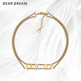 Doni d'alfabeto online-Banda doppia collana Torques girocollo moda vintage bronzo oro alfabeto regalo per donne Grils gioielli