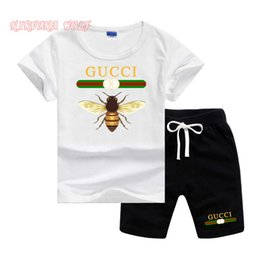 girl kids t shirt design Promo Codes - GVCH Little Kids Sets 1-7T Kids T-shirt And Short Pants 2Pcs sets Baby Boys Girls 95% Cotton Pattern Design Printing Style Summer Sets lw03