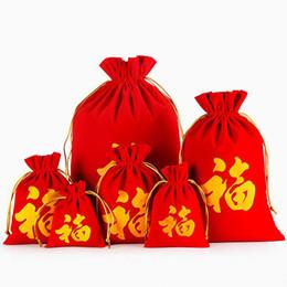 Bolsas de la suerte de navidad online-10 unids / lote Hotselling Estilo Chino Suerte FU Letra Bolsas de Terciopelo Rojo Bolsas Feliz Año Nuevo Bolsa de Embalaje Bolsas de Regalo de Navidad