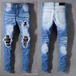 Pantalones de bicicleta hombres online-Nuevo diseñador para hombre Jeans flaco con delgado elástico Denim Fashion Bike Jeans de lujo hombres pantalones rasgado agujero Jean para hombre más tamaño 29-40