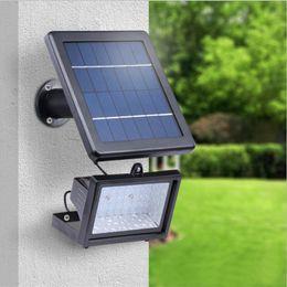 Потолочные светильники онлайн-Солнечные светодиодные прожекторы 30 светодиодных прожекторов Открытый проектор Ландшафтный сад Газон Лампа Солнечная энергия Настенные светильники