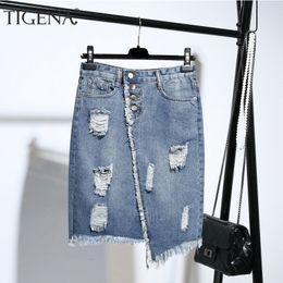 Chiave per foro online-Tigena Plus Size Mode Midi Denim Rock Donna 2019 Estate Light Blue Hole Jeans strappati Rock Key femminile Quaste School Rock Y19071601