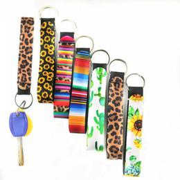 Sacchetti di partito di stampa del leopardo online-Colorato stampato portachiavi portachiavi Lily Neoprene Bag Charmer Pulitzer portachiavi Leopard a righe girasole Festival Party Regali WX9-1423