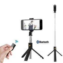 2019 lente de zoom 12x teléfono móvil Nuevo mini trípode extensible inalámbrico Bluetooth Selfie Stick para iPhone / Huawei Control remoto de obturador monopod portátil plegable