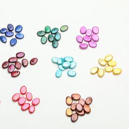 JNMM 20 pcs Perla Suelta Rainbow Forma Oval Perlas de Agua Dulce Teñidas Cuentas de Colores Mezclados con Gran Grado para Regalo desde fabricantes