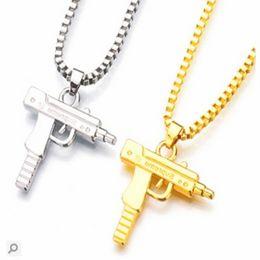 Encantos de jóias com pistola on-line-201.909 Ouro Charme Cadeia Colar Homens Mulheres Moda Marca Gun Forma colares muito tempo pistola Pendant Hip Hop Jewelry Unisex Christmas Gift M629F