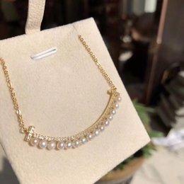 2019 sonrisa de perla Material de latón de calidad superior con forma de sonrisa con diamantes y collar de perlas para las mujeres regalo de la joyería envío gratis PS61 sonrisa de perla baratos